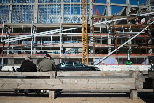 Men Watch US Bank Stadium