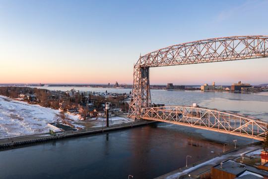Duluth Lift Bridge Sunrise in Winter - Visit Duluth Aerial