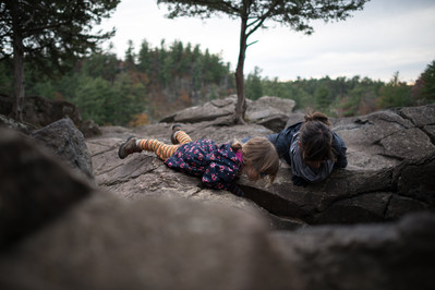 Mother and Daughter Peer into Interstate State Park Potholes