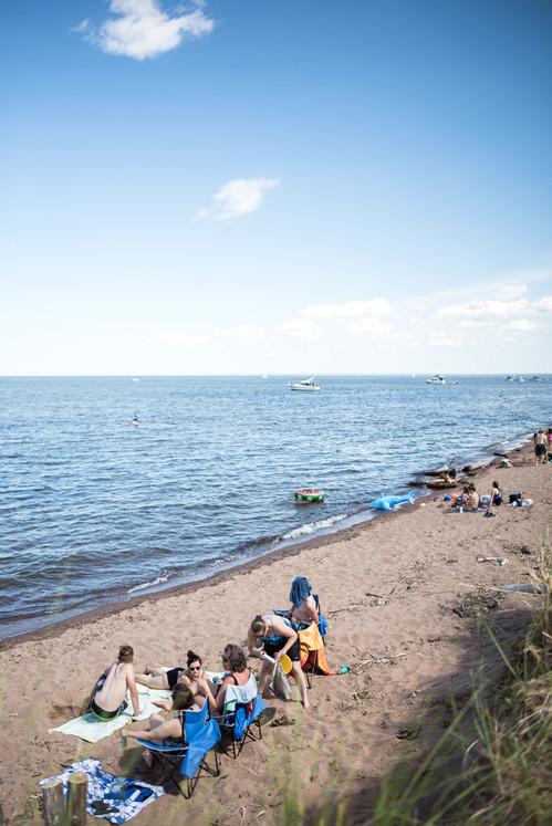 Beach-goers at Park Point Beach