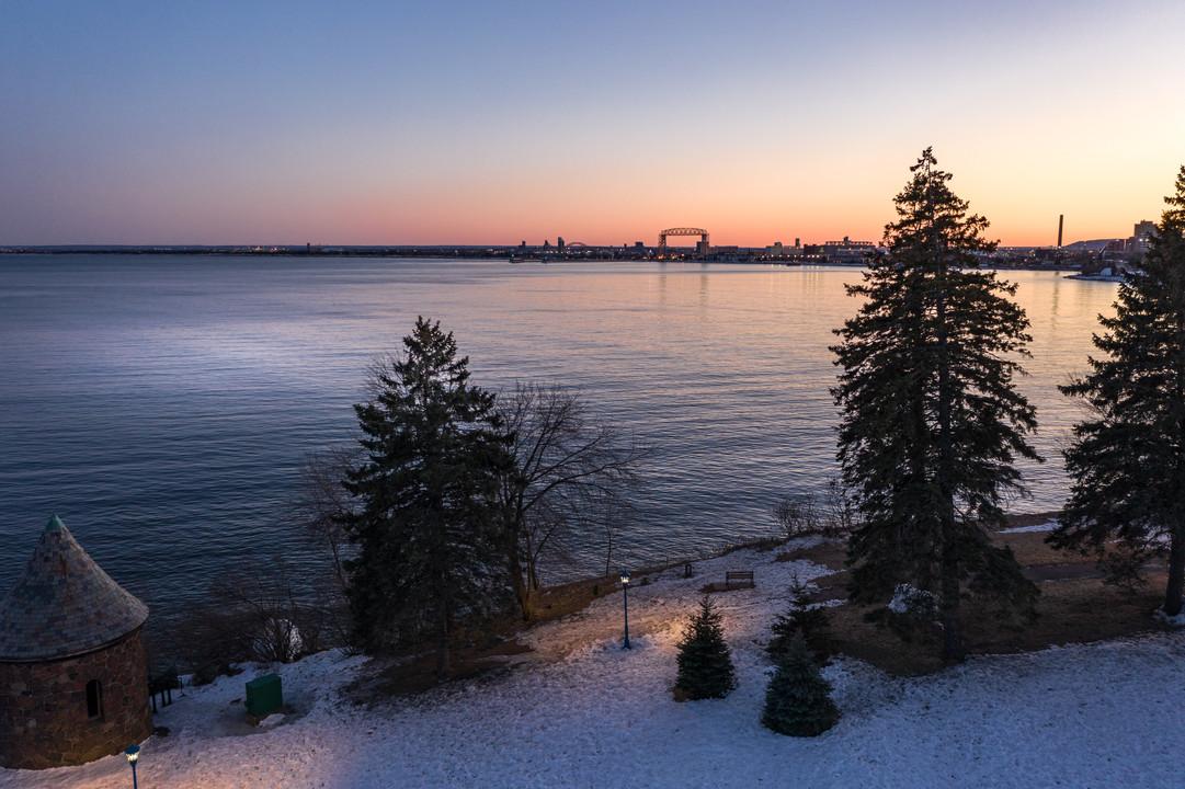 Leif Erikson Park and Lift Bridge Winter Sunset - Duluth Lift Bridge Sunrise in Winter - Visit Duluth Aerial
