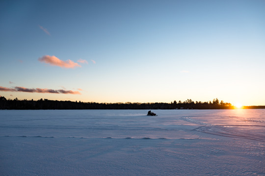 Snowmobile Across Three Lakes Chain of Lakes