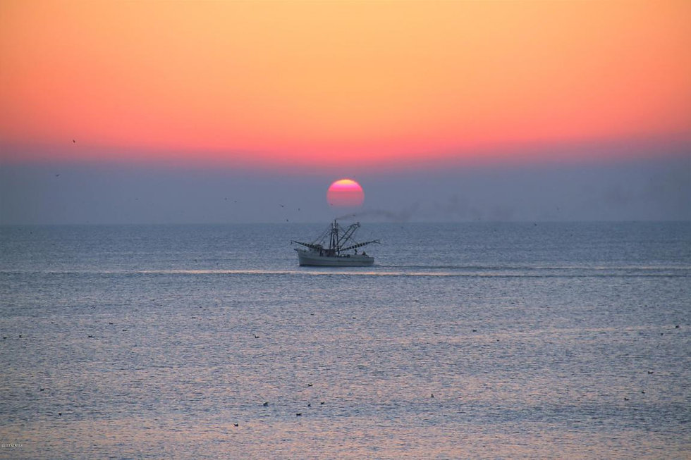 sunrise with boat and sun.jpg