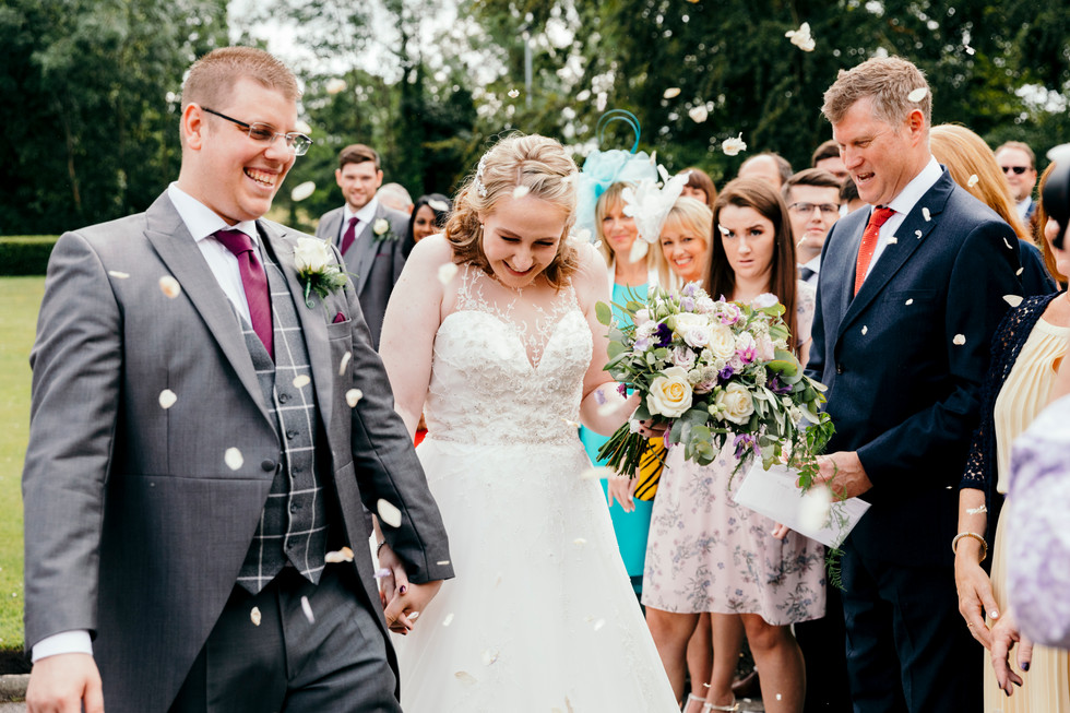 BRide and Groom at Cheshire Wedding with Confetti