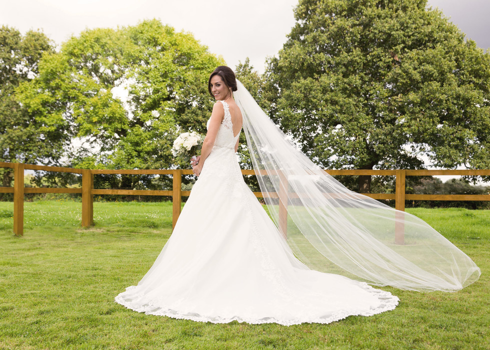 Bride looking lovely in a gown from Puure Bridal Cheshire