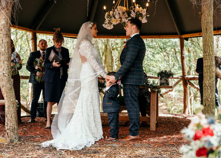 Cheshire Woodland Wedding Bride and Groom during Ceremony with son