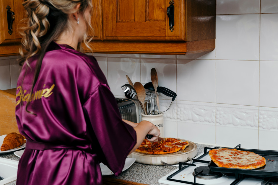 Bridesmaid sorts out Pizza during Wedding Preperations