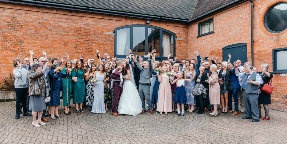 Guests cheer on Bride and Groom during formal photos at Stratford Park Hotel and Wedding Barn