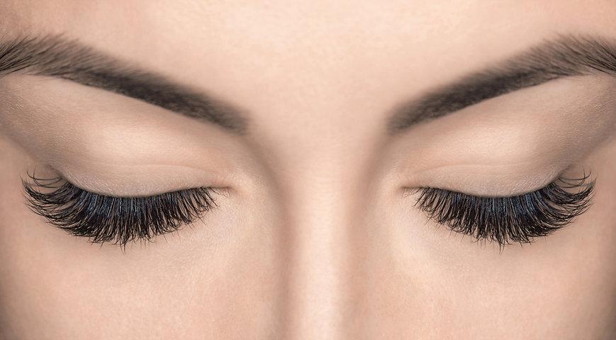 Eyelash extension procedure. Beautiful W