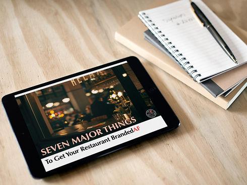 black-ipad-mini-notebook-table.jpg