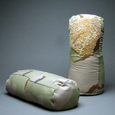 """Don't ask, don't tell (2010),  old army jacket, sequins, glass beads, thread, sand,  14"""" x 8"""" x 8"""" (each)"""