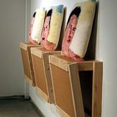 "Pillow Talk (2012),  2"" x 4""s, wood paneling, yarn, latch hook canvas, thread,  poly-fil, 3"" bolts, nuts, washers,  56"" x 48"" x 48"" (detail)"