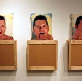 "Pillow Talk (2012),  2"" x 4""s, wood paneling, yarn, latch hook canvas, thread,  poly-fil, 3"" bolts, nuts, washers,  56"" x 48"" x 48"""