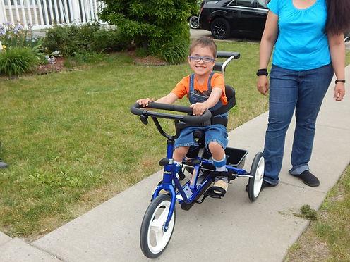 Zachary on Maksym's Wheels bike.jpg