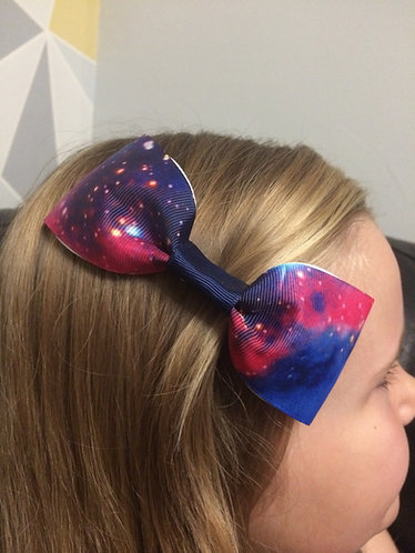 Galaxy inspired bow with navy ribbon centre