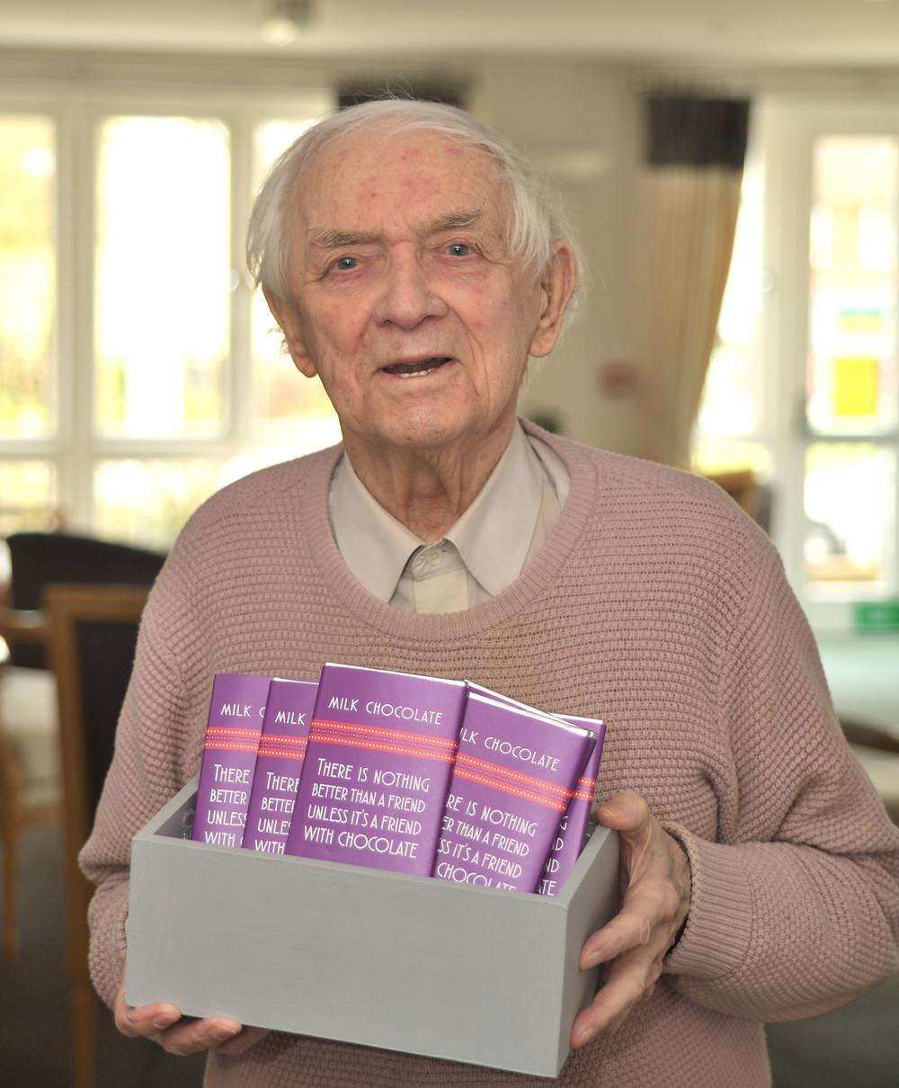 WWII veteran John Clark with Easter chocolate