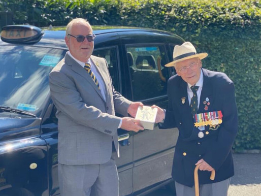 Taxi Charity is delivering commemorative tins to veterans for VJ Day