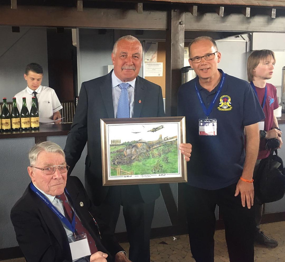 Bill Gladden presents mayor of Ranville with watercolour of My Memory