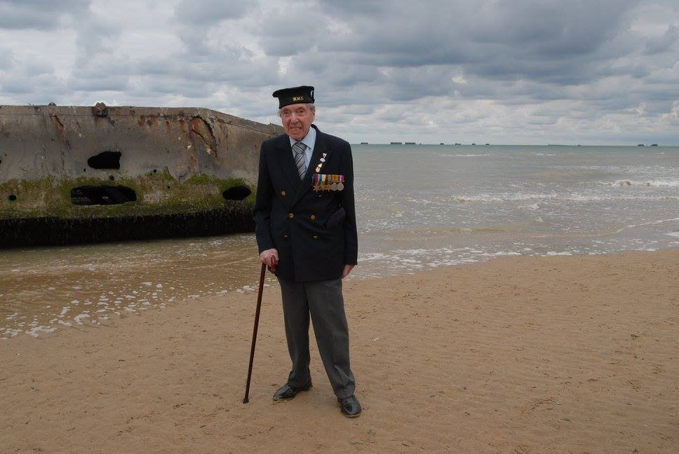 Peter Kent at Mulberry Harbour in Arromanches