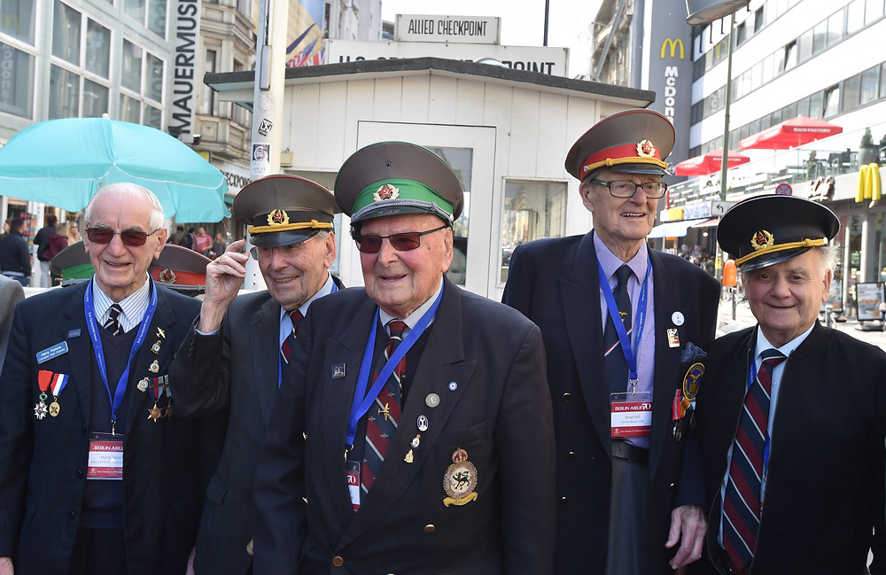 Bill (second left) at Checkpoint Charlie