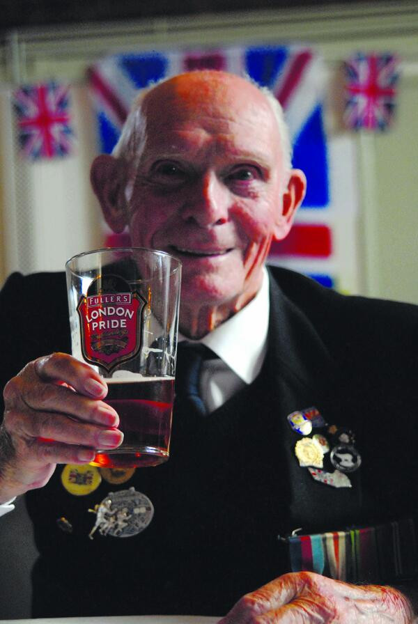 Percy Moss enjoys a pint on the Taxi Charity's annual outing to Worthing, June 2014