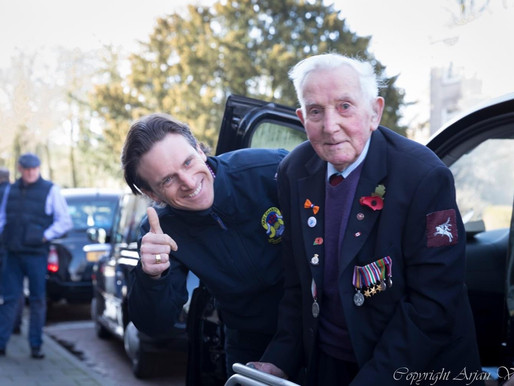 WWII veteran Ray Whitwell talks to Taxi Charity volunteer, Seb Philp