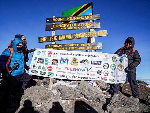 Three London cabbies reach Kilimanjaro summit to raise thousands for war veterans