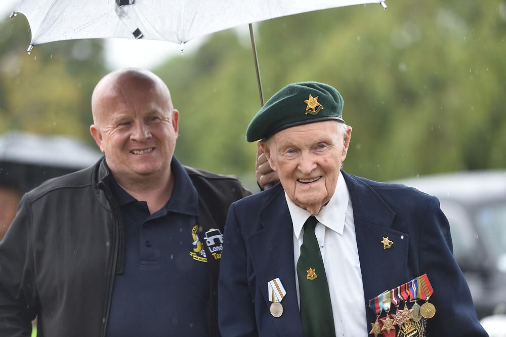 Volunteer Brian Heffernan with Cyril Banks