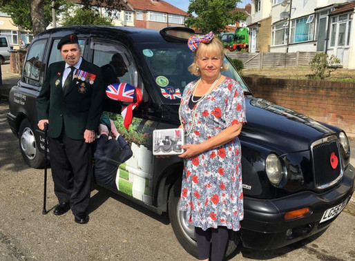 Taxi Charity delivers VE Day commemorative tins to veterans