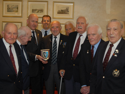 Taxi Charity presented with shield by The Glider Pilot Regiment Association