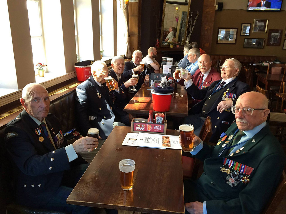 The collectors raise a glass to fellow collector George Seal