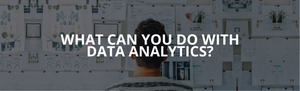 What can you do with data analytics? A man stares at a wall of paper.