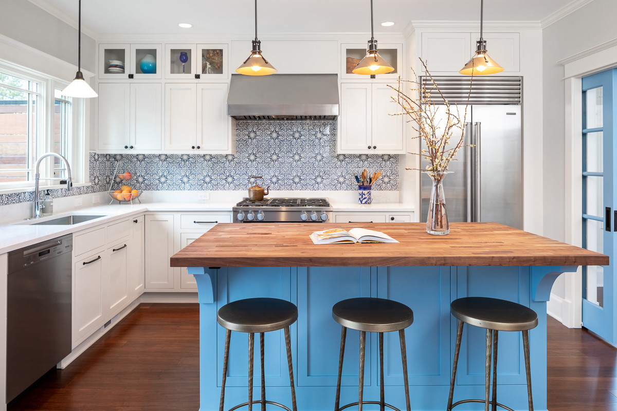 The kitchen, with its brass accents, classic blue and white palette was featured on Houzz for best kitchen.