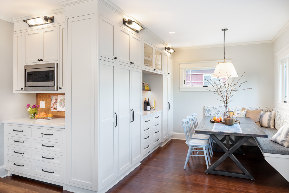 Inset Cabinetry adds Pantry Storage highlighted by Visual Comfort Lighting