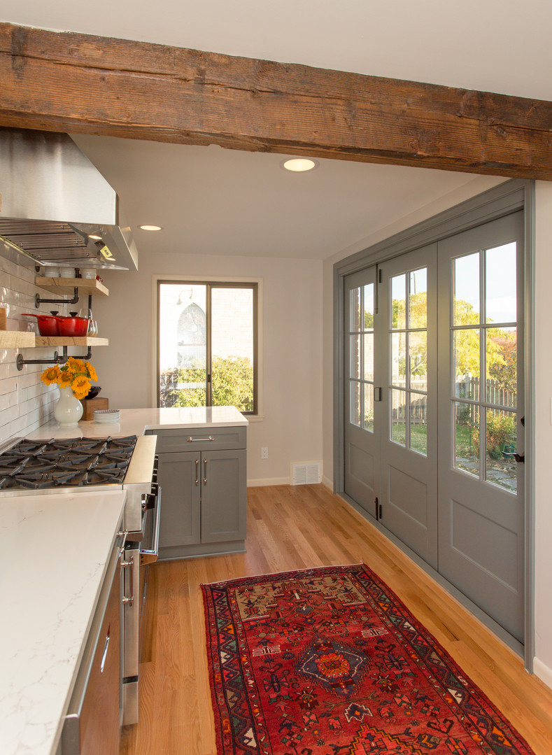 This narrow light filled kitchen doubles in size with its stackable doors