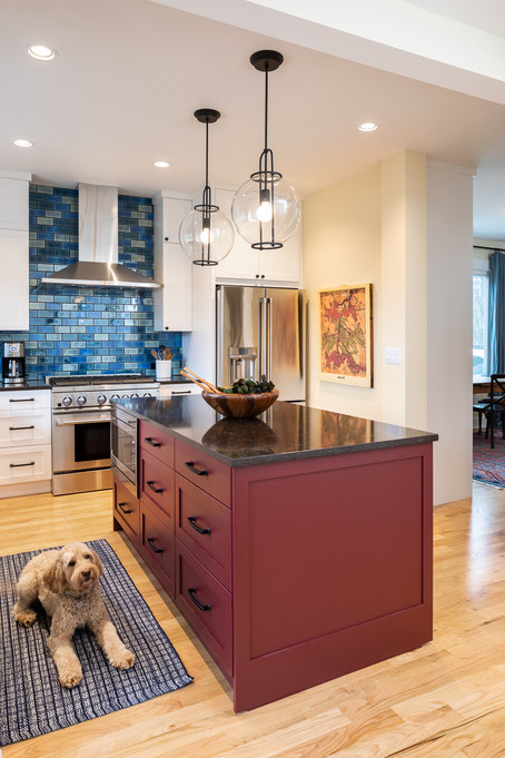 We designed an island brimming with storage and allowing for a much needed countertop space.