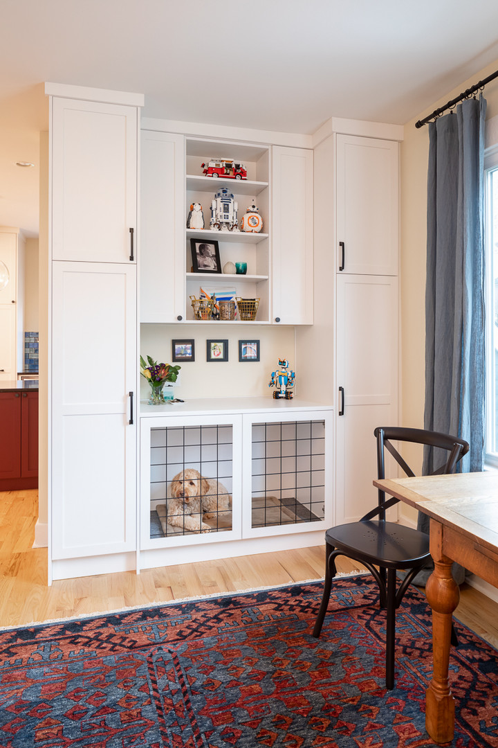 We keep every family member in mind during the design process.  Sophie needed a place for her crate. We integrated her crate into a custom wall cabinet.