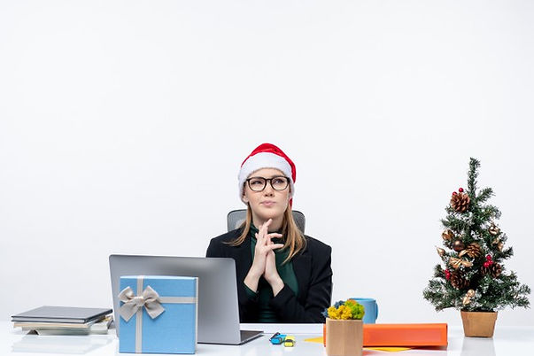 concentrated-business-woman-with-santa-c