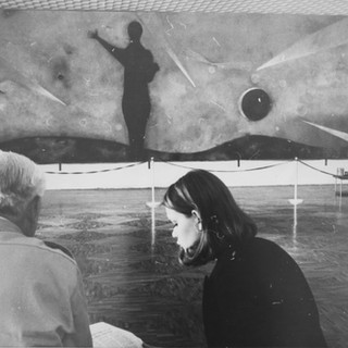 """Seated with Rufino Tamayo in front of his mural """"El Hombre Frente al Infinito,"""" 1971"""