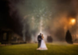 best wedding photographers in Essex bride and groom with fireworks