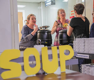 Attendees enjoy soup and bread.jpg