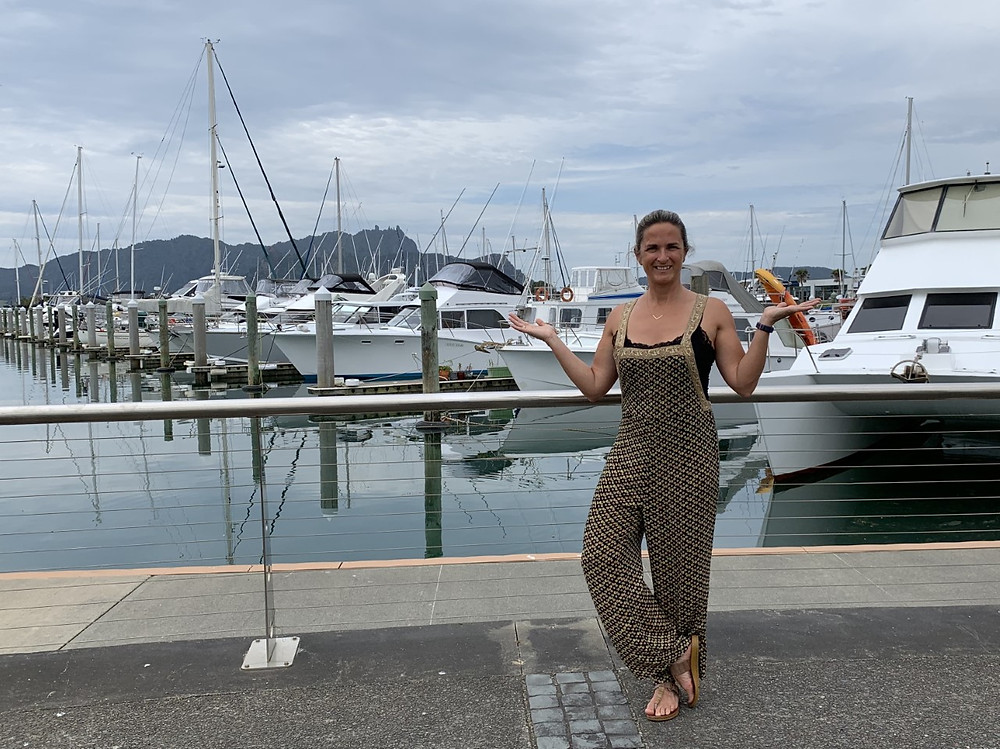 Lady standing in front of recreational boats docked at a marina