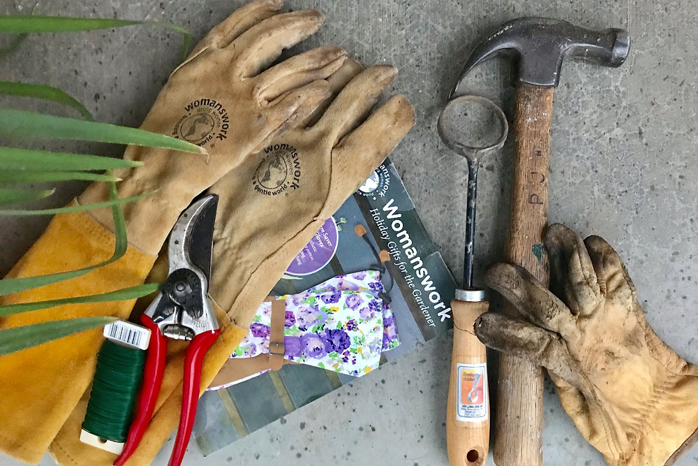 Tools of my garden life: gloves, clippers, wire, circle hoe and grandfather's hammer. Choosing the right tools makes a difference. Photo by J. Jewell.