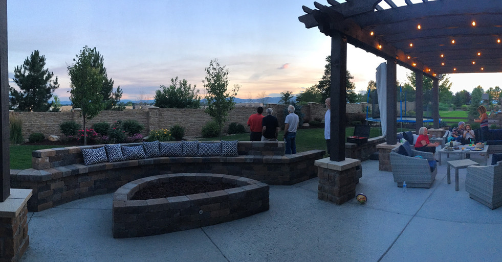 A seat wall and fire pit are entertaining elements perfect for turning large gatherings into intimate affairs.