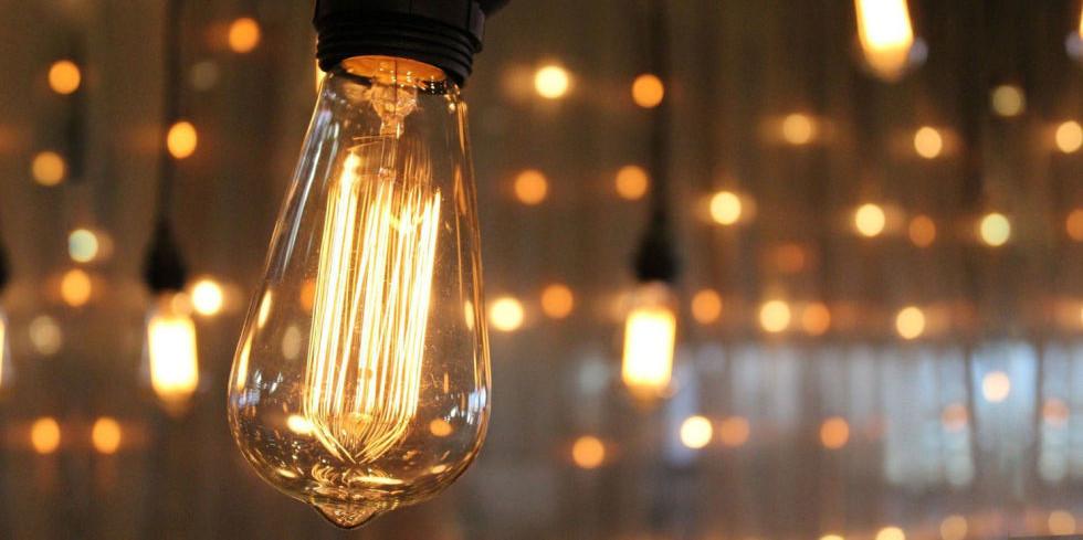 Edison bulbs bathe the patio in soft light.