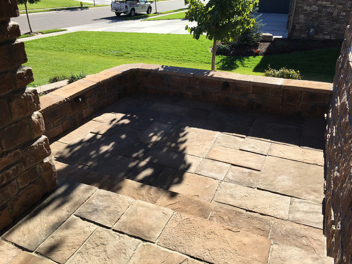 One of two sunken front porch patios.