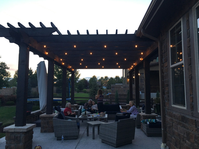 Pergolas on both ends of the patio create intimate rooms for entertaining.