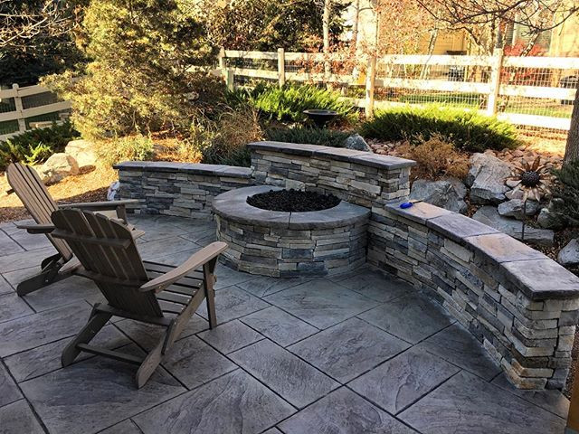 A gas fire feature with built in seat wall for extra seating allows for a fire even on Colorado's burn restricted days.  Stone veneer to match the house is a classic touch that can increase a home's value.