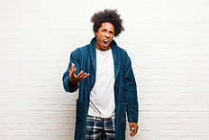 young-black-man-wearing-pajamas-with-gow