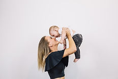 smiling-woman-playing-with-baby_23-21477